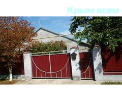 Дом с земельным участком в с.Почетное